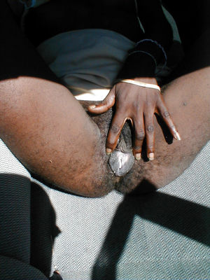dark-hued mammy showcases his furry dark-hued labia in the car for a passers