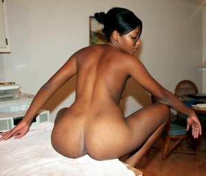 Amateur ebony GF showing ass and pussy on kitchen