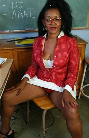 The old black teacher in red panty, an erotic photo from the classroom