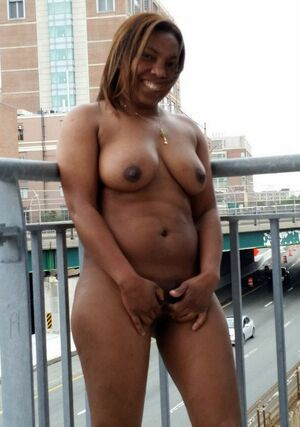 Sexy ebony wife Keisha posing naked in morning city